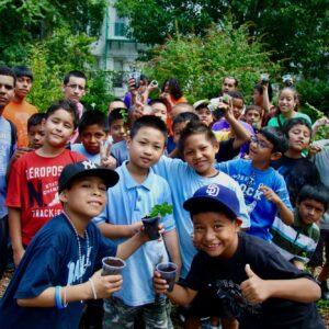 kids holding plants